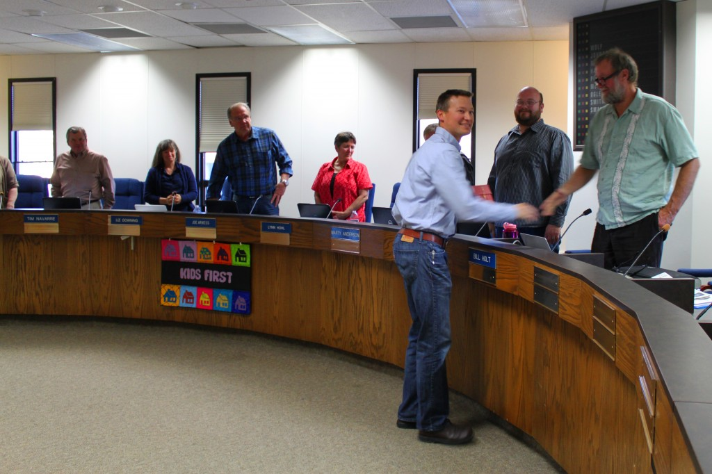 Mike Petersen, Project GRAD executive director, receives Golden Apple award from KPBSD Board of Education