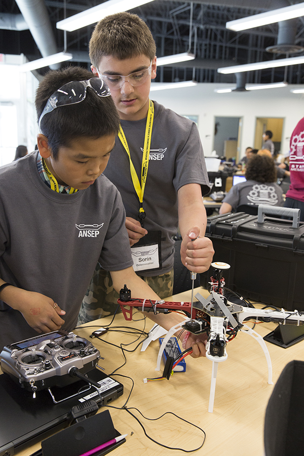 Marcus Hale (L) and Sorin Sorensen (R), put finishing touches on their Unmanned Aerial Vehicle at ANSEP's STEM Career Explorations in June 2015