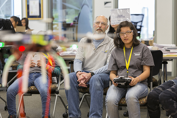 Daylynn Yenney, ANSEP STEM Career Explorations student, pilots the UAV her team built while university professor looks on, June 2015