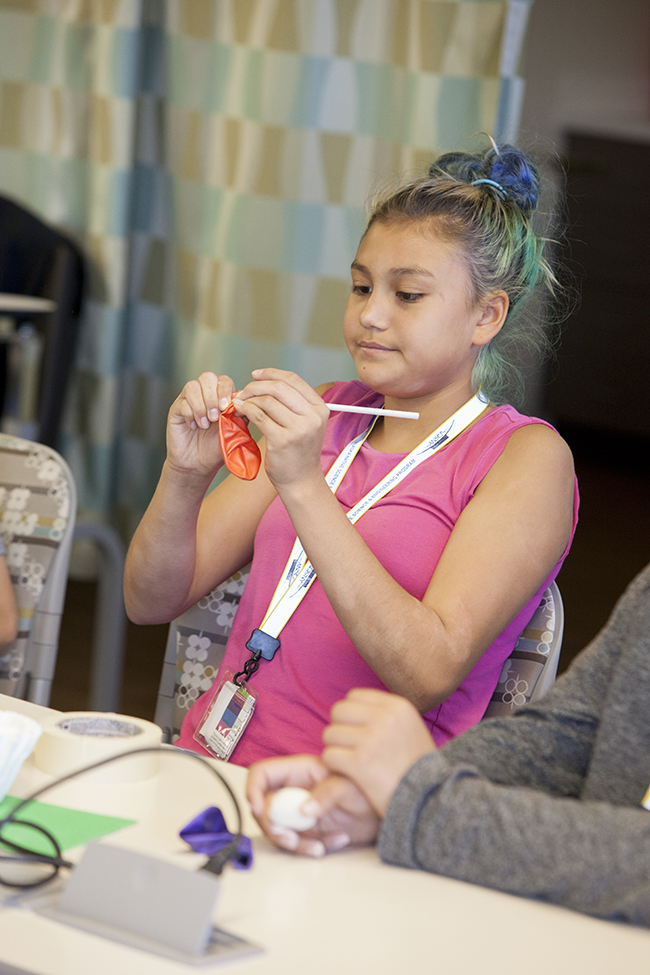 Aphanasia Kvasnikoff creates model lungs during ANSEP's STEM Career Explorations in July 2015